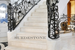 Cream marble stairs with solid stone stringer