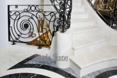 Large grand step on marble stairs